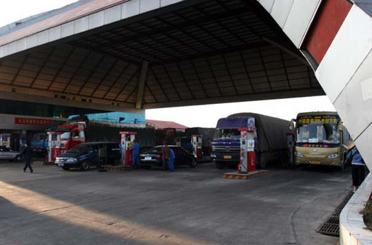 Trucks line up at a gas station outside Kunming before heading south - Andy Scott/ASIA BRIEFING
